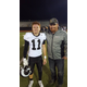 Brady Reed stands with his dad after a football game. (Reed family)