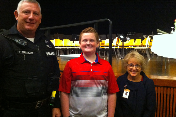 Edward and Ryan Poisker with Heidi Stark, principal of Ingomar Middle School