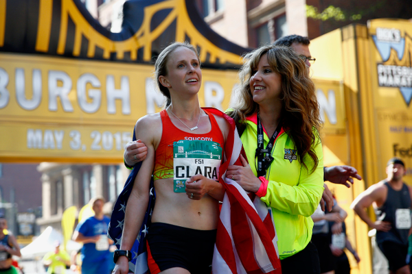 Clara Santucci, winner of the 2015 Pittsburgh Marathon, with Patrice Matamoros