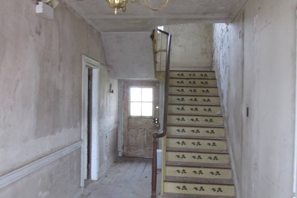 The main stairway inside the front door of the Red Rose Inn.