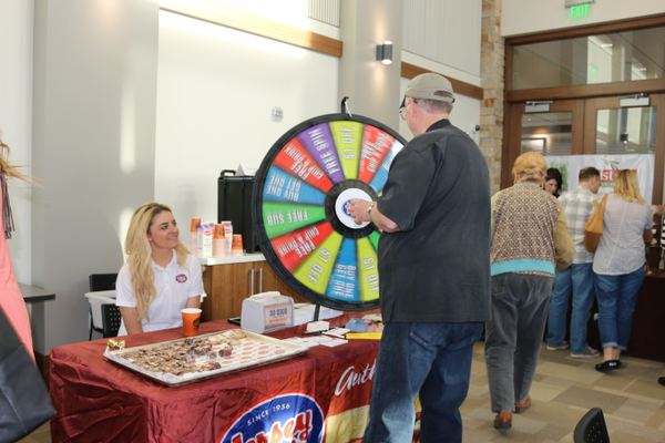 Shayla from Jersey Mike's had prizes available at the spin of a wheel. The chocolate- chip cookies didn't require a spin. (Cassie Goff/ City Journals)
