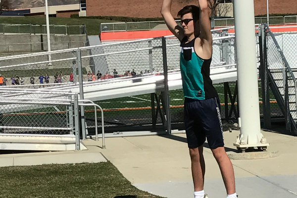 Junior thrower Kyle Nobis warms up before Brighton's throw trials on March 15. (Koster Kennard/ City Journals).