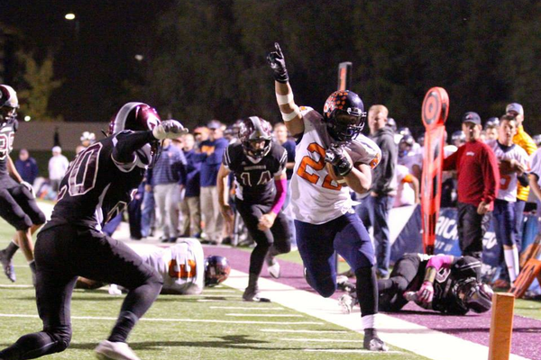 Sione Lund puts his figure in the air as he runs toward the end zone in Brighton''s game versus Jordan. (Richelle Hadley Lund/Facebook)