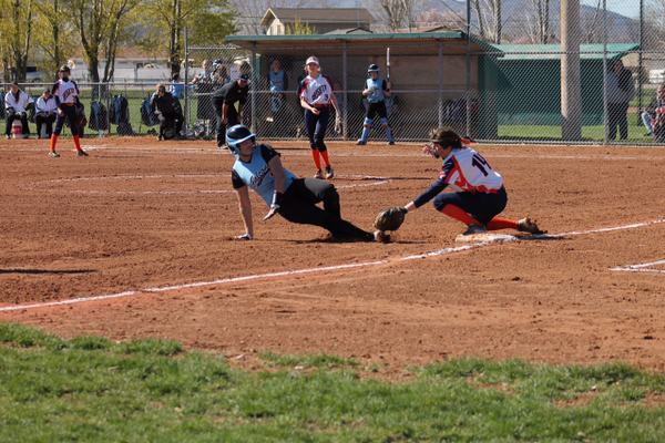 A Brighton player tags an opponent out before she reaches second base. (Josh Woodside/ Brighton Softball Assistant Coach)