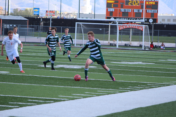 Senior Matt Lockwood drives forward from his outside back position. Lockwood scored in the second half at Murray. (Travis Barton/City Journals)