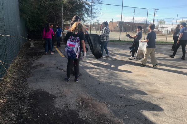 It was a team effort to get the cleaning done, and the kids had a blast using their rubber gloves and garbage bags. (Natalie Mollinet/ City Journals).