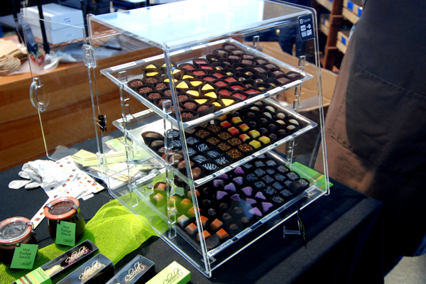 Chocolat's array of rainbow- colored truffles. (Keyra Kristoffersen/City Journals)