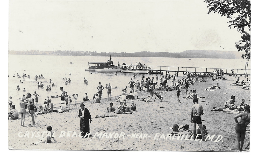 A Postcard From The 1930s 1940s Shows Crowd At Beach With Reybold S Wharf Behind Them