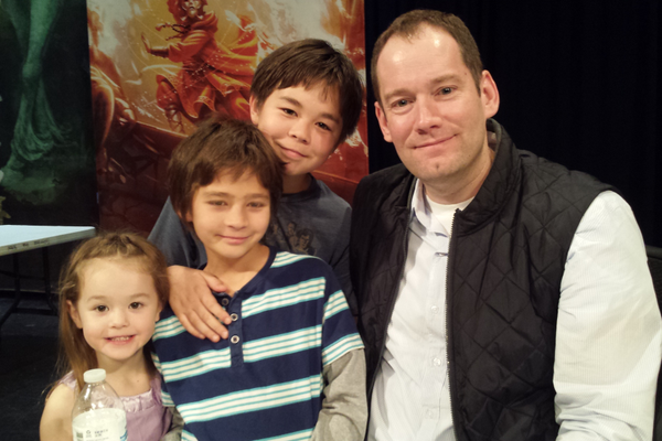 "Kiah, Gage and Kaden Maw met author Brandon Mull at the launch party for ""Dragonwatch."" While reading ""Dragonwatch,"" Kaden said he wished it would never end. (Taylor Maw)"