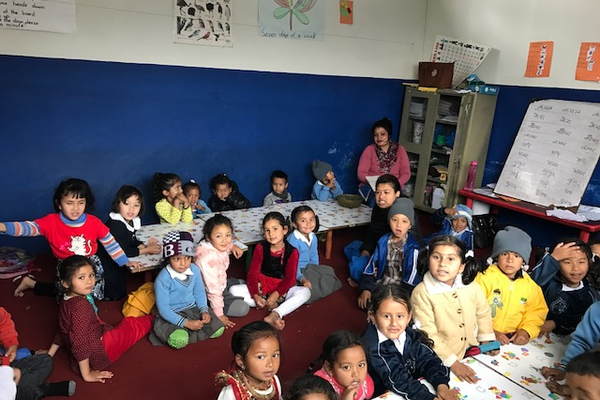 Channing Hall Head of School Heather Shepherd visited Nepal's Sunshine National School where kindergartners sat on the floor and learned their lessons on long tables. (Heather Shepherd/Channing Hall)