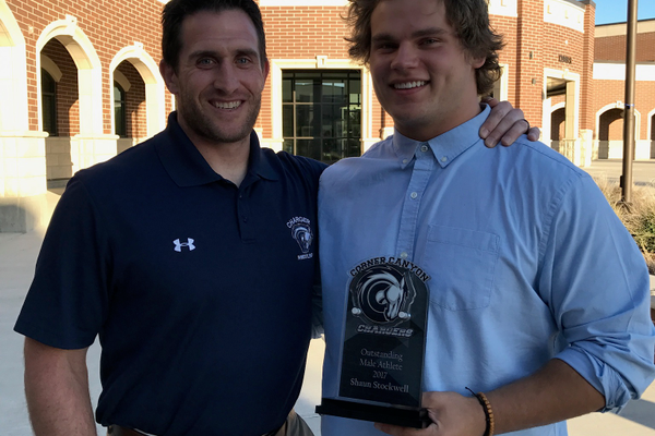 Corner Canyon head coach Jeff Eure stands with senior Shaun Stockwell after Stockwell won the school's Male Athlete of the Year award. ((Robin Simmons/Corner Canyon wrestling)