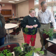 Shown at the senior center L-R are Lena Rogers Penny Brunderett and  John Root looking over the perennials he brought to the presentation
