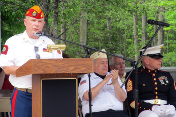 Jim Hastings, chairman of the Memorial and Veterans Day Committee, acknowledges Grand Marshal William Vicini (middle) and Marine First Sergeant Steven Pereira, the keynote speaker at Bellingham's 146th Memorial Day ceremony.