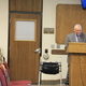 Mayor Ted Eyre presents his and the city's tentative budget plan for the 2017-18 fiscal year at the May 2 city council meeting with his wife behind him. (Mandy Ditto/City Journals)