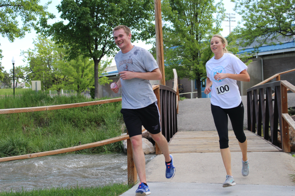 Miss Murray Alyse Horton and Joe Feichko cross the bridge at Murray Park during the final stretch of the Drop the Drugs 5K Fun Run and Walk. (Travis Barton/City Journals)
