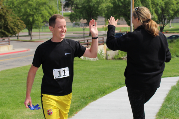 Taylor Read (left) receives congratulations shortly after taking first in the Drop the Drugs 5K Fun Run and Walk. (Travis Barton/City Journals)