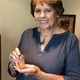 Grace DeVries holds the perfume bottle that started her collection. (Alisha Soeken)