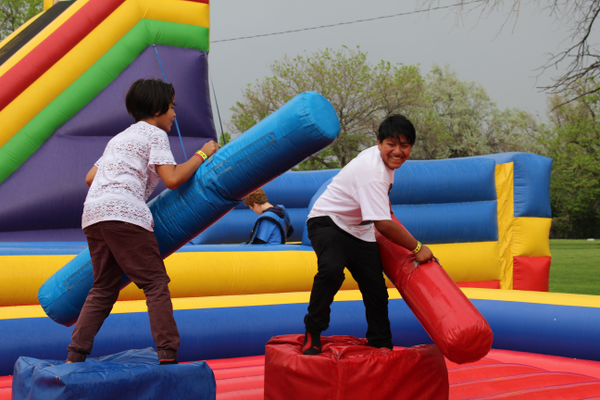 Kids could play in inflatable bounce houses during the Midvale Cinco de Mayo celebration. (Travis Barton/City Journals)