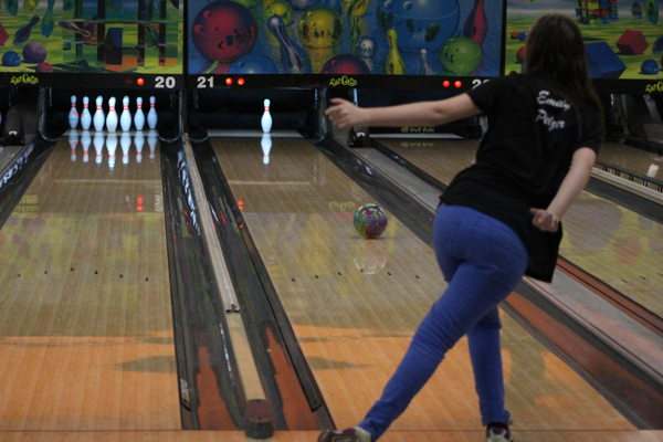 Emily Pelzer completes a spare while practicing at Fat Cats. Pelzer, who averages a bowling score of 176, has been winning bowling tournaments since she was 8. (Travis Barton/City Journals)
