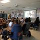 West Jordan High School students watch the reaction of Bolivian children receiving portraits the students drew of the children. The video was created by The Memory Project. (Jet Burnham/City Journals)
