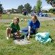 Henry Rieck and Nikki Rieck dig around gravestones to make them pretty for Memorial Day. (Keyra Kristoffersen/City Journals)