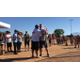 Jon Clifford stands before a large crowd at closing ceremonies. (Sarah Nelson/Southeast Valley Baseball)
