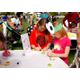 Rebekah Brinton and Mia Kiernan paint ladybugs and bees onto rocks at the Ladybug Festival. (Keyra Kristoffersen/City Journals)