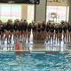 Celebration began shortly after the Mustangs were awarded first-place medals at the girls state water polo championships. (Mike Goldhardt/Herriman water polo
