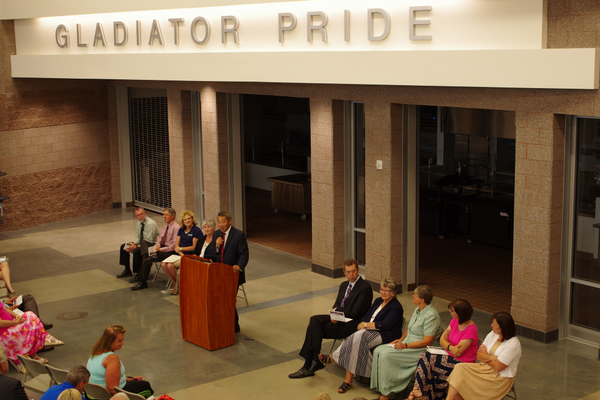 Murray School District Superintendent Steve Hirase is seen speaking at Hillcrest Junior High's 2015 dedication. Current Hillcrest Junior High Principal Jennifer Covington, seated third from left, will assume the duties of superintendent July 1. (Julie Slama/City Journals)
