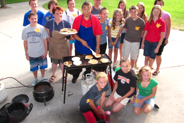Murray School District Superintendent Steve Hirase, seen here cooking a Mountain Man breakfast for student leaders at Riverview Junior High in 2012, will retire June 30. Current Hillcrest Junior High Principal Jennifer Covington will assume the duties of superintendent.