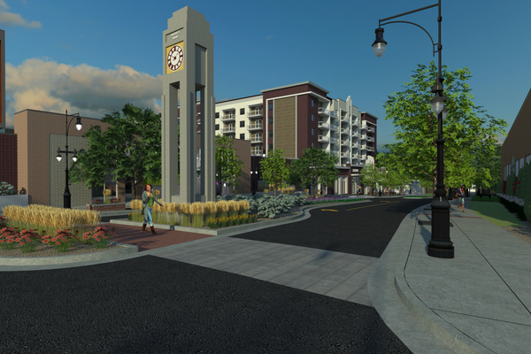 A pedestrian view of the project near Payless Shoes at the mid-block of the new street. The large crosswalk and landscaped median slow traffic and provide walkability from the parking garage to nearby shopping and dining. In the median, a large clock tower provides visual interest on the block and pays homage to Sugar House's history. (Westport)