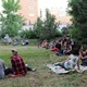 People sit and listen to the music during the Hidden Hollow Concert Series. (Travis Barton/City Journals)