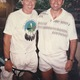 John and Film Director/Actor Robert Redford pose for a photo after one of their tennis lessons. (Robert Redford staff)