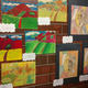 """Second-graders' pieces inspired by """"Tete d'une Femme Lisant,"""" which means """"Head of a Woman Reading,"""" by Pablo Picassoand""""Tahitian Landscape"""" by Paul Gauguin. (Jet Burnham/City Journals)"""