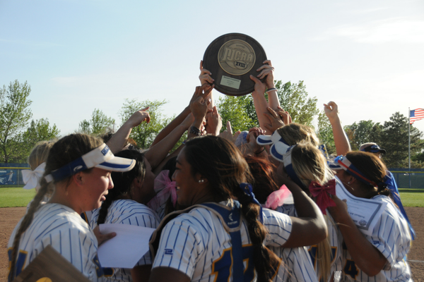 The celebration began early as the Bruins hoisted the Region 18 trophy. (Wade Tycksen/SLCC softball)