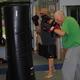Denise Lovett leads a kickboxing fitness class at Cornerstone Martial Arts in Hockessin
