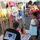 Passersby could add their own artistic flourishes to various canvases at one booth during the Night on Commonwealth in May. (Travis Barton/City Journals)