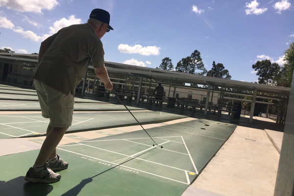 Shuffleboard has been played in Florida since about 1913. It dates back centuries to a game of sliding large coins. Photo courtesy of Lee County Shuffleboard Club.