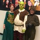 """From left, Cadence Dobson as Princess Fiona, Kagan Vann as Shrek and Caleb Massari as Donkey before the production of """"Shrek: The Musical Jr."""" at the North Fort Myers Academy for the Arts on June 23."""