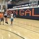 Player goes through her jump shot as teammate and coach watch. (Koster Kennard/ City Journals)