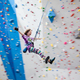 A participant in one of Momentum's many youth programs comes down from the wall with exuberance. (Momentum Indoor Climbing Gym)