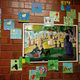 """Fifth-graders created their own pointillism pieces inspired by """"A Sunday on La Grande Jatte"""" by Georges Seurat. (Jet Burnham/City Journals)"""