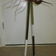 A whimsical mosquito made of found objects by Roberta Little.