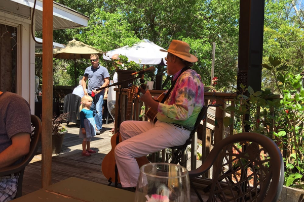 """Tie dye Ted singing at brunch at the Survey Cafe. Perfect!"" Photo and caption courtesy of Amy G. on Yelp."