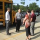Principal Shawn Dutkiewicz (left) confers with staff members about the new bus schedule.