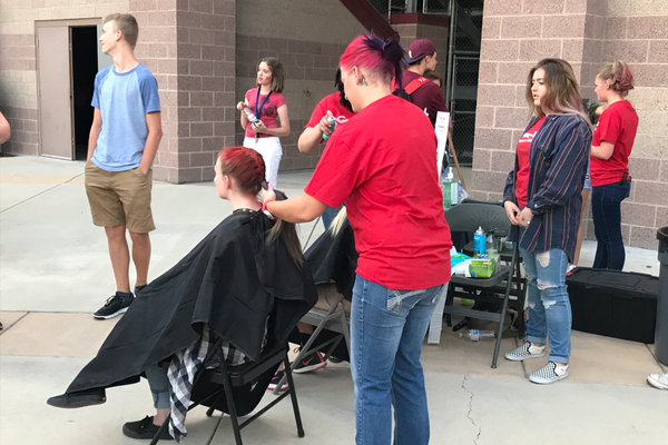 As part of the midnight madness party, Great Clips colored students' hair and gave away free haircuts. (Greg James/City Journals)