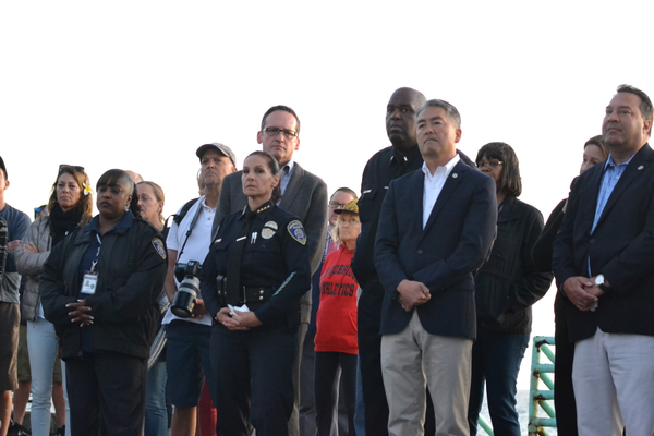 Police Chief Eve Irvine joins local officials and family members at the candlelight vigil.