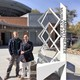 James Schultz (left) and Evangelos (right) crafted the Murray Park Amphitheater art piece. (Shaun Delliskave/City Journals)