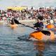 Racers in pumpkin boats row their fastest across Oquirrh Lake at the 2017 Ginormous Pumpkin Regatta. (LiveDaybreak)