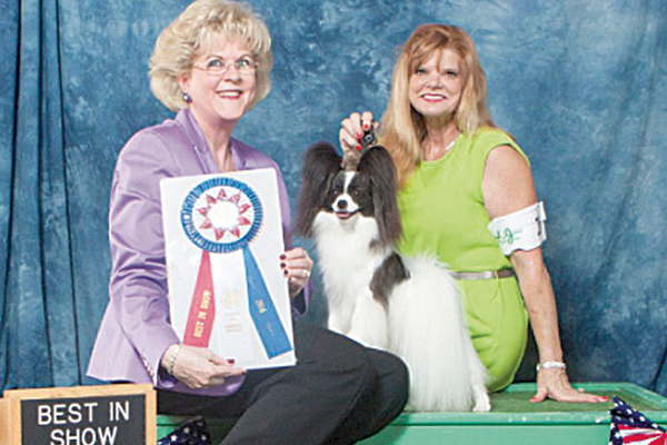 Kiki Maginnis and her handler after Kiki won her first AKC All-Breed Best In Show.